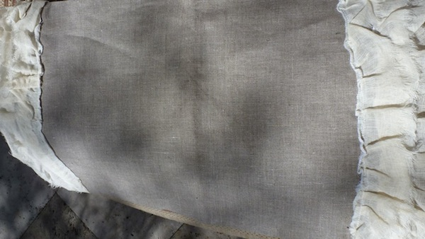 Linen pillow with ruffle trim